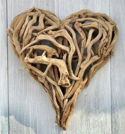 This charming hand-crafted driftwood heart will add dimension and texture to your walls. It can be hung indoors or outside.