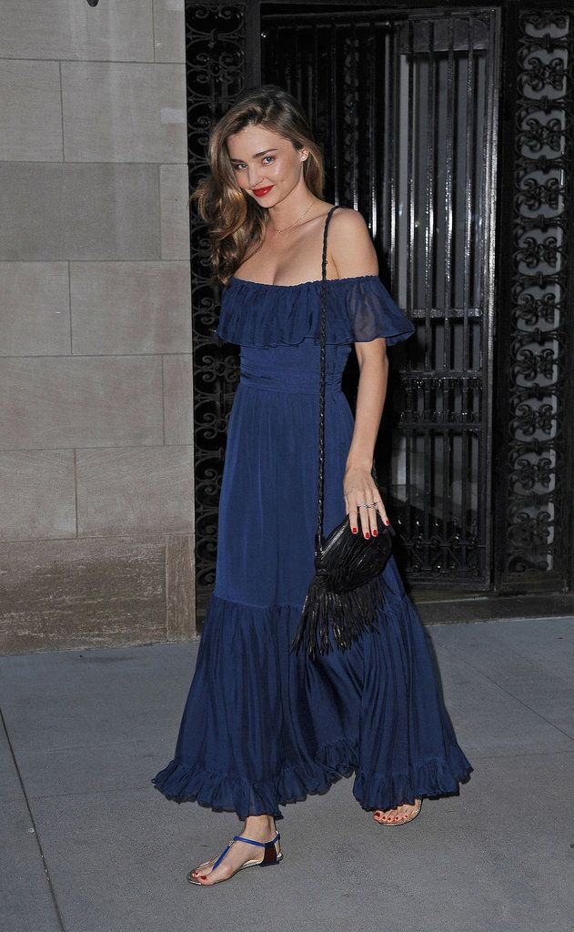 Miranda Kerr was feminine as ever in an off-the-shoulder navy maxi dress while out in NYC.
