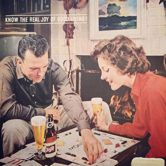 1960 Schlitz Beer ad features a cute couple playing Monopoly.