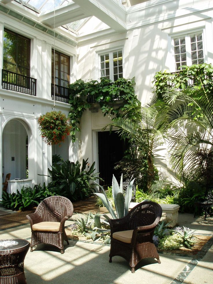 15 best courtyards images on pinterest indoor courtyard for Homes with enclosed courtyards