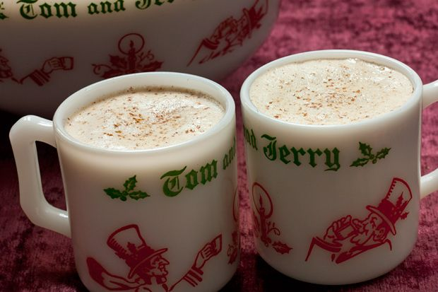 Tom and Jerry     This classic hot Christmas drink reminiscent of eggnog has a fluffy spiced batter spiked with Cognac and rum.