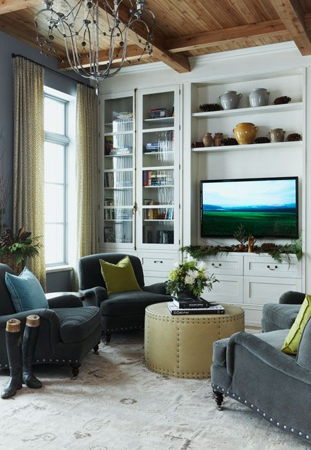 natural pine ceiling, built in bookshelves, gray walls, velvet nailhead chairs and ottoman.  Michael Graydon photography.