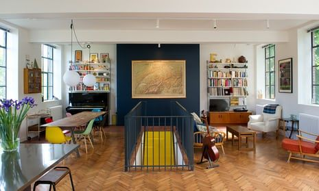 The first floor living/dining and kitchen space with its original parquet floor. The Eames dining chairs are from scp.co.uk, the vintage map is of Switzerland, owner Carlo Viscione's country of birth.
