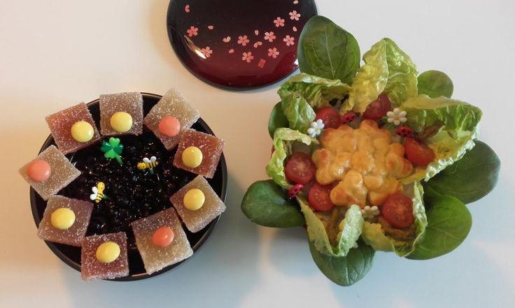 """#42 Francoise France Mon bento est un """"bento fleurs"""" : fleur de tournesol pour le dessert avec un cheese cake aux myrtilles pour le coeur et des pétales gourmands en pâte de fruits avec en plus quelques bonbons en chocolat coloré;  fleur végétarienne pour le plat avec de la verdure de saison:feuilles de laitue et d'épinard frais, asperges et tomates cerises qui entoure un coeur """"fleur """"en pâte feuilletée pour rappeler que les gâteaux peuvent être salés."""
