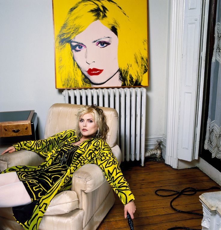 Debbie Harry with Warhol portrait in her New York apartment, photographed by Brian Aris, 1988.