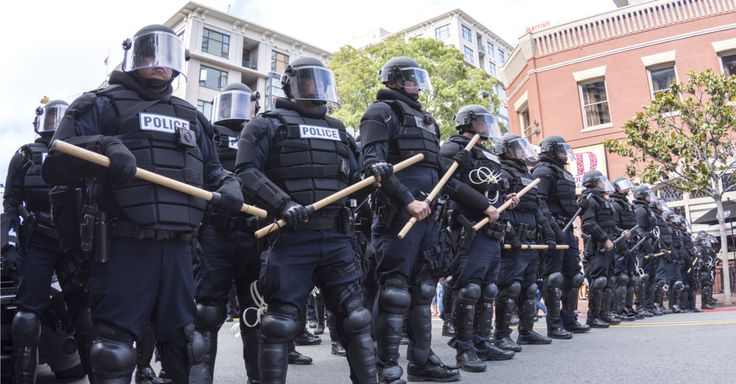 PEOPLE WAITING FOR SOMETHING TO HAPPEN - Riot police in full tactical gear waiting to confront protesters at a Trump rally at the San Diego Convention Center Photo: Chad Zuber