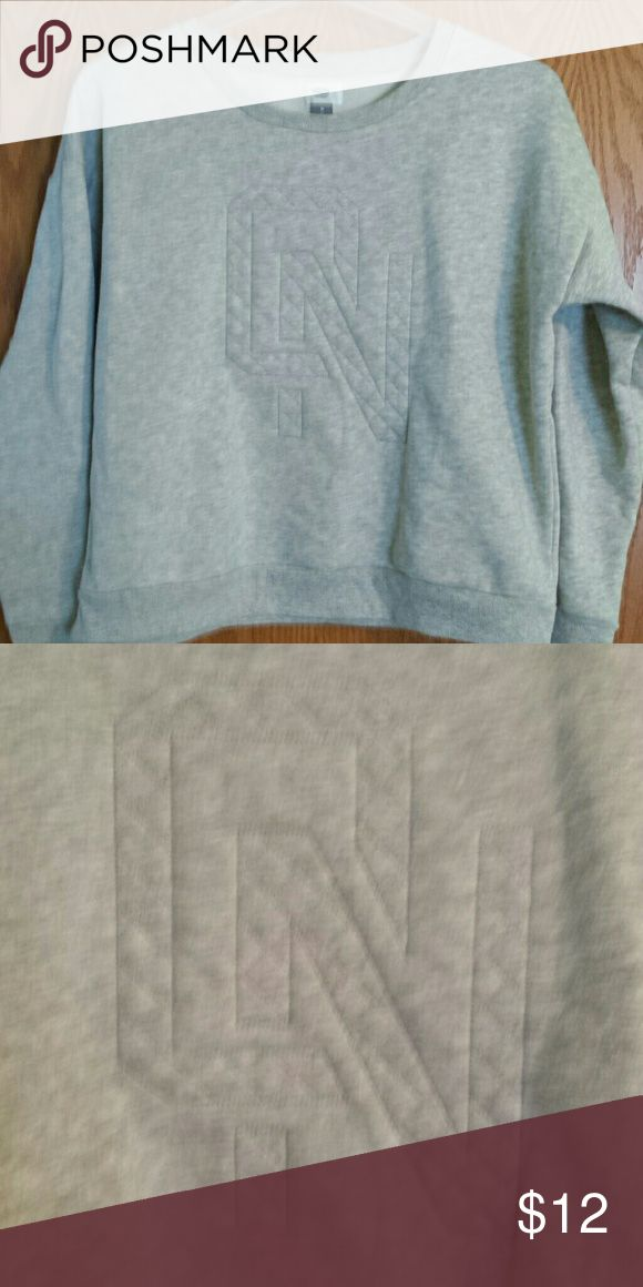 """OLD NAVY SWEATSHIRT Worn once, excellent condition, gray sweatshirt by old nany, size Medium Woman's,  has the """"O.N."""" logo textured on the front. Old Navy Tops Sweatshirts & Hoodies"""