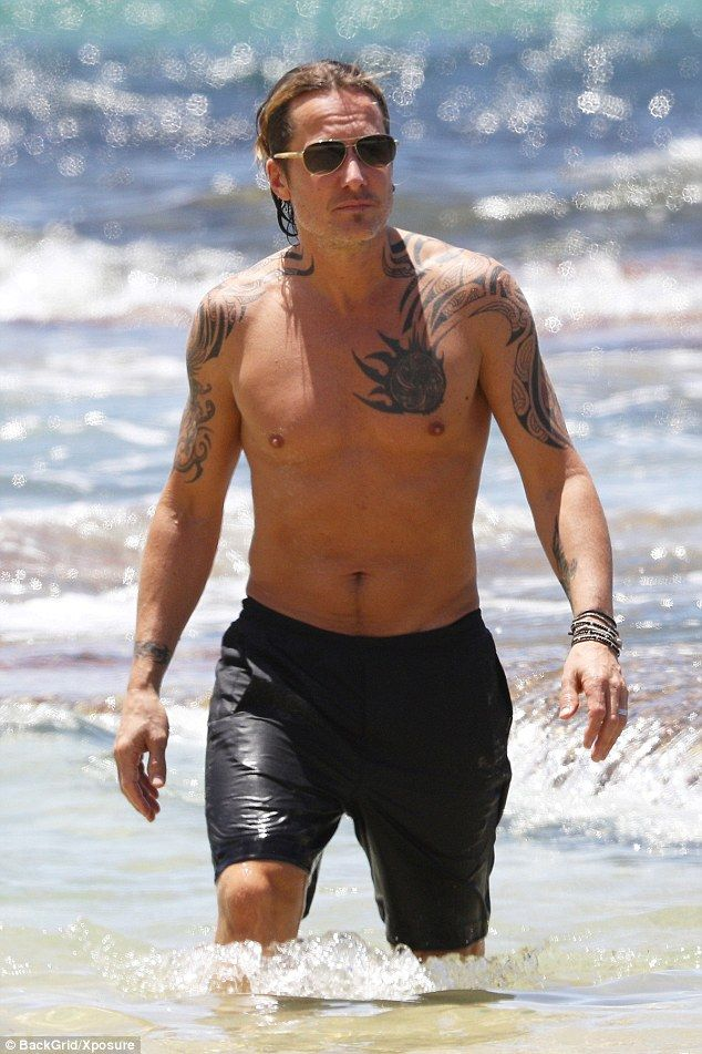 Hunky:The couple, both 49, showed off their incredibly youthful figures as they larked ar...