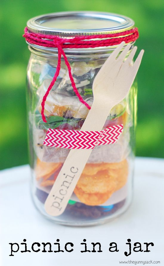A Picnic In A Jar is one of the mason jar crafts that's perfect for parties. Customize the food and colors for the party or shower!