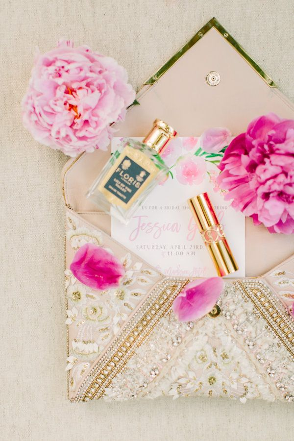 Chic beaded clutch: http://www.stylemepretty.com/2016/05/31/why-flower-bars-are-the-new-it-bridal-shower-detail/ | Photography: Love & Light Photographs - http://loveandlightphotographs.com/
