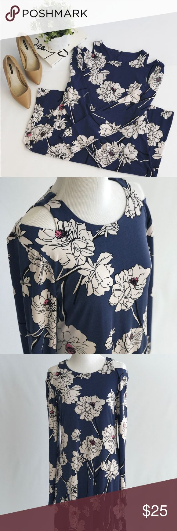 Shoulder Cut-Out Floral Dress Beautifully bloom in this Ivanka Trump midi dress in floral print. Dresses Midi