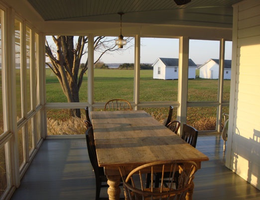 harvest table on a big open porch