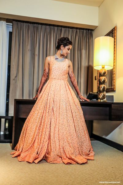 Peach floor length sleeveless voluminous full flare sparkly gown with sequin work, fairytale, girly, pastel