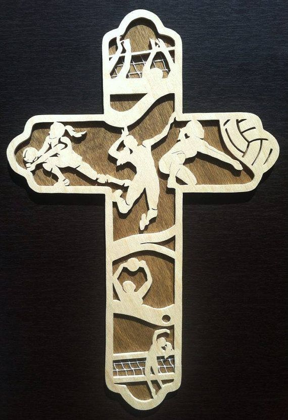 This volleyball themed cross was handmade from quality 1/8 Baltic Birch. The delicate front panel of the cross has a clear Varathane finish while the back panel is stained a dark brown to reveal the woods natural grain- the contrast of light and dark woods looks great on display. This is the perfect gift for the volleyball fanatic!  Dimensions: 12 x 8 x 1/4 Command strip included for easy hanging