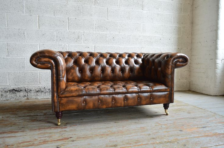 Traditional British handmade 1857 deep buttoned Chesterfield Sofa, shown in gold antique leather. 2 seater. | Abode Sofas