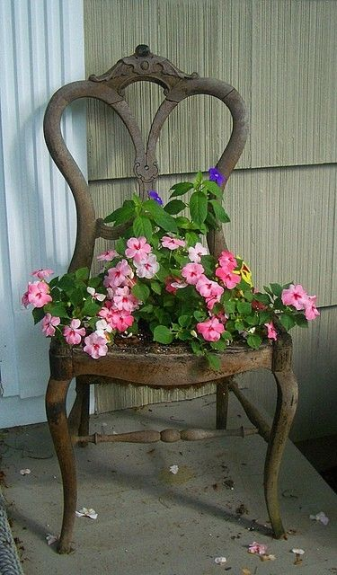 An old chair with the seat removed and planter inserted in it's place is a popular choice and is great because it can be moved around!