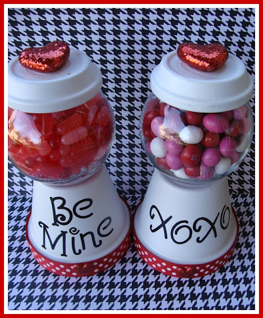 1 Clay pot  1 Clay pot saucer  1 Small glass fish bowl  Spray Paint  Stickers/Embellishments/Ribbon  and of course....CANDY!