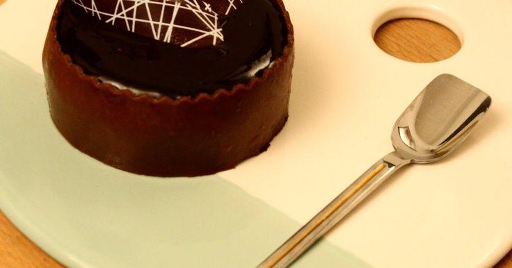 Mini dark chocolate and orange cream cake.  Layers of moist chocolate sponge Gran Marnier cream and dark chocolate ganache.  We love to get warmer with calories!