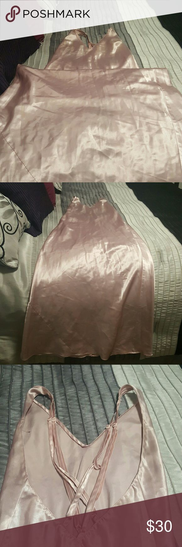 Frederick's of Hollywood pink silk nightgown Frederick's of Hollywood pink silk nightgown with open criss cross back detail. Comes down to the floor!!!! Will accept reasonable offers Frederick's of Hollywood Intimates & Sleepwear Chemises & Slips