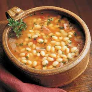 Hearty Navy Bean Soup Recipe- Soak Navy beans for four hours. Into the pressure cooker they go, and they should be covered by at least 2 inches of that meaty broth for a good soup. Add more liquid if needed. High pressure for 12 minutes. Use the natural release so the skins don't split.