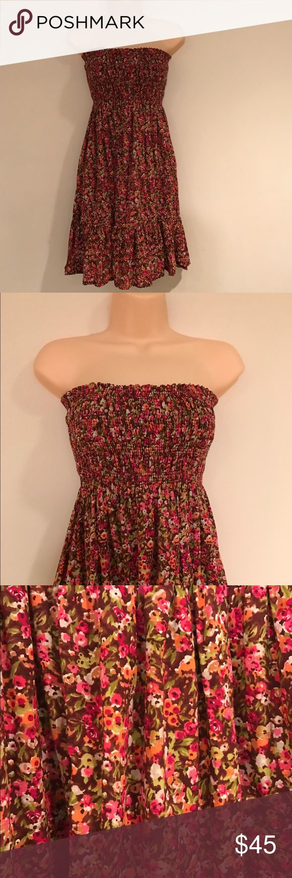 Floral Summer Dress Victoria's Secret website purchased. Worn once. Beautiful floral print, strapless, tube top dress. Perfect paired with cowboy boots, also listed in my closet, sold separately. No trades, buy now or make an offer. Moda International Dresses Strapless