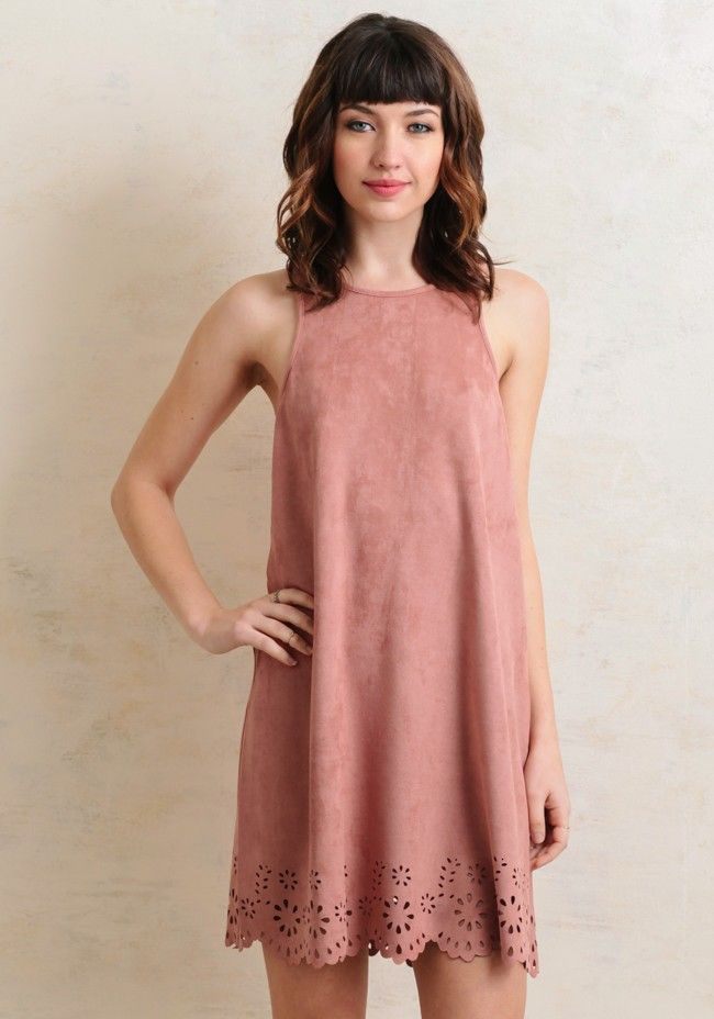 Ideal for a date with the beau, this dusty pink dress is rendered in a luxuriously soft faux suede fabric and an exposed back zipper closure. Accented with a scalloped hem and floral laser cutout...