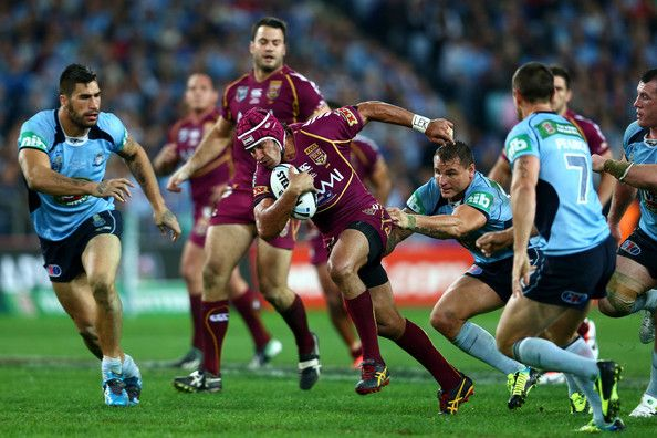 Johnathan Thurston of the Maroons makes a break during game one of the ARL State of Origin series between the New South Wales Blues and the Queensland Maroons at ANZ Stadium on June 5, 2013 in Sydney, Australia.