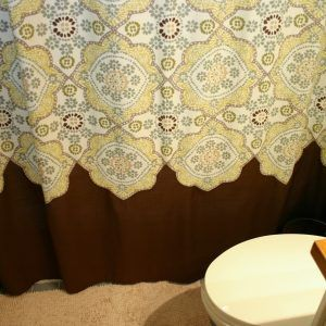 brown and yellow shower curtain