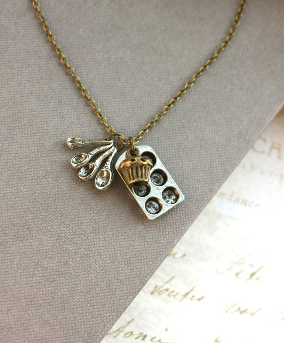 Great gift for a baking friend!  A Bakers Necklace. A Measuring Spoon, Silver Miniature Baking Tray Muffin Necklace.