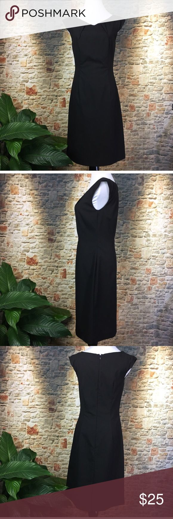 "Mossimo Lil Black Dress, size 4. Mossimo Lil Black Dress, size 4. Perfect for work and then moving into an evening out with the right accessories. Measurements are bust laid flat 17.5"", waist is 15.5"", shoulder to hem is 36.5"". Mossimo Dresses Midi"