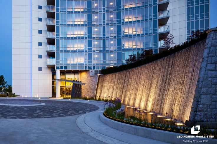The Dramatic Curved Water Wall At Aviara In Burnaby By