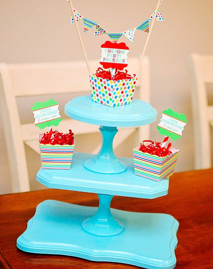 DIY cupcake stand using wooden plaques and candlesticks.  So cute!