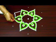 simple and latest rangoli design || color kolam designs with dots || muggulu type design - YouTube