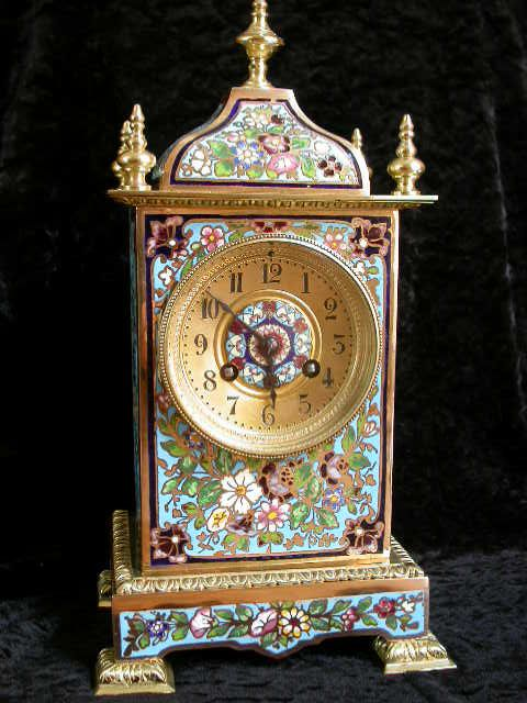 A very attractive Champleve enamel mantel clock with an abundant floral decoration. The overall ground colour is a turquoise enamel. with a blue/purple theme. The Gilt arabic clock dial is enhanced with a champleve enamel roundel. The Vincent movement bears the awarded  Medal D'Argent 1855 stamp. The 8-day clock strikes the hours on a coiled gong and is numbered 9822 with matching pendulum. Circa 1900