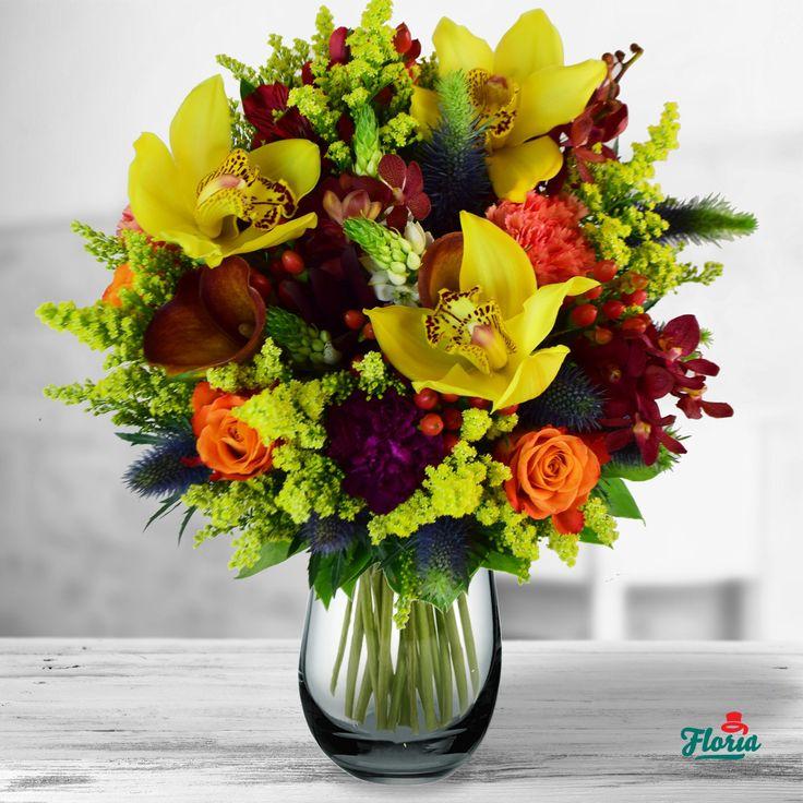 Gadila simturile, invaluindu-te in toate culorile toamnei, ca și cand florile ar vorbi in soapte intelese doar de cei care iubesc. Daca si tu le intelegi, trimite mai departe freamatul florilor de toamna! Acest buchet contine: 4 hypericum rosu, 3 cale portocalii, 3 cymbidium galben, 3 ornitogalum alb, 2 eryngium, 3 mokara grena, 2 garoafe portocalii, 4 solidago, 1 garoafa mov, 3 trandafiri portocalii, salal. Dimensiuni: 40 cm (inaltime) - 35 cm (diametrul buchetului)
