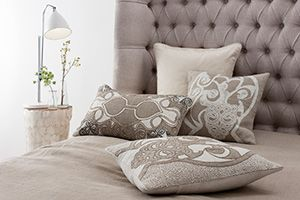 Intricate appliqué and embroidery to recreate the beauty of an ancient Celtic artefact. Aztaro cushions £130 |  Available to buy from http://www.luxdeco.com/brands/aztaro
