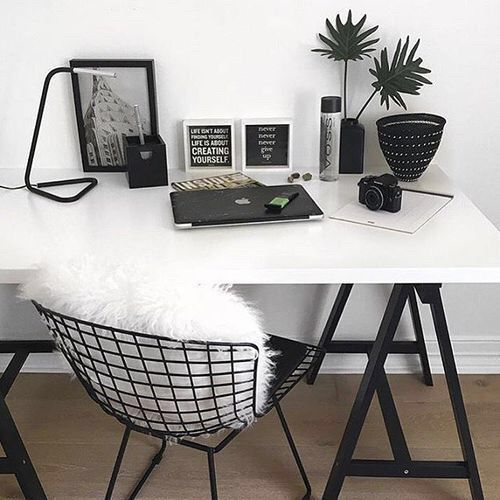 white desk w/ black hairpin legs black wire chair w/ white pillow or throw add black table or book shelf/wall shelves