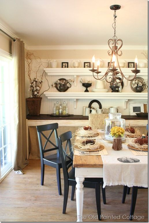 Loving the shelves/built in counter as an alternative to a hutch or china cabinet. I see baskets under the counter for storage.