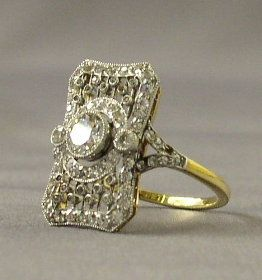 Found in a Titanic expedition - 18k gold, and diamond ring.