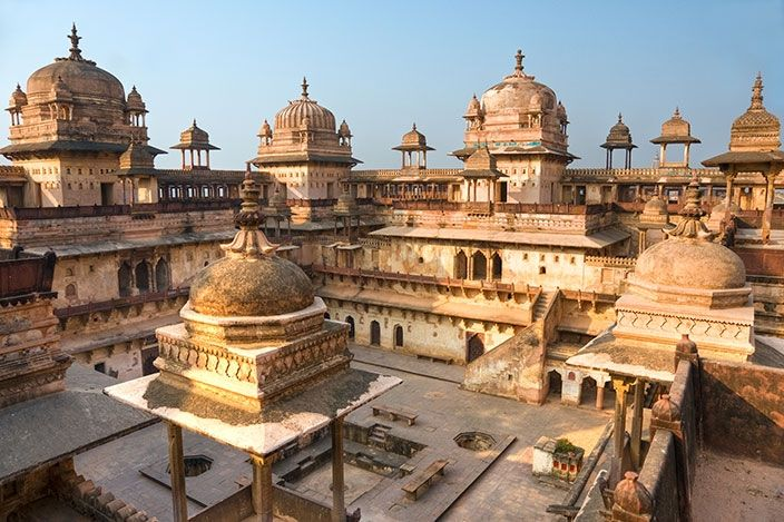 Jahangir Mahal, 16th century citadel completed in 1598. The Timurid domes, galleries and inner courtyard offer an impressive architectural spectacle, one of many notable encounters offered by Orchha.
