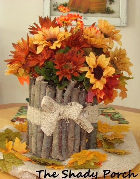 Rustic Fall Centerpiece...with a twig covered vase...from The Shady Porch.  There are 10 fall inspired centerpieces on this blog with instructions for each one.