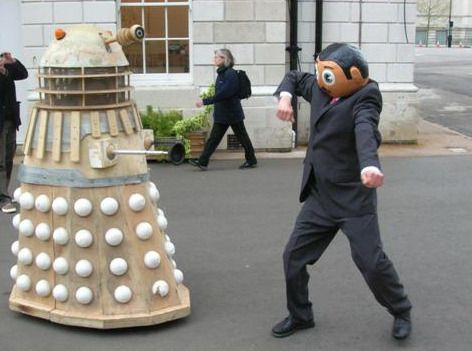 A Dalek and Manchester singer (and star footballer!) Frank Sidebottom enjoy a lovely tango outside of Chelsea Space, where they performed Samuel Beckett together, London, England, United Kingdom, 2006, photograph by Shirlaine Forrest.