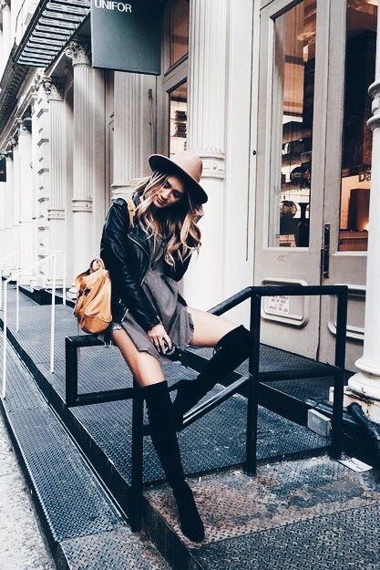 Over-the-knee boots styled with a nice casual dress.
