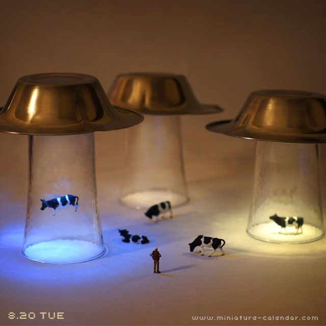 UFO party decor, flying saucer abducting cows. Probably wouldn't ever have one of these but pretty cool