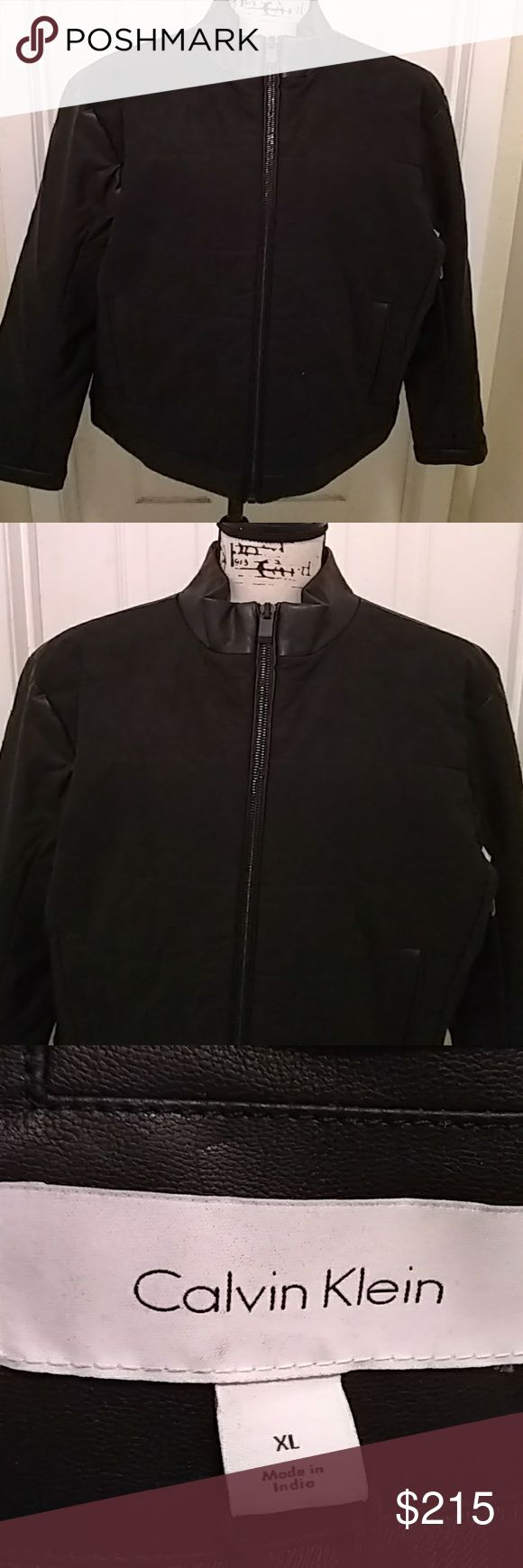 Men's Calvin Klein leather and suede coat This Calvin Klein leather/suede jacket is perfect for any season. The front body is suede while the back, arms etc are all leather. A beautiful coat for anytime wear. Calvin Klein Jackets & Coats Bomber & Varsity
