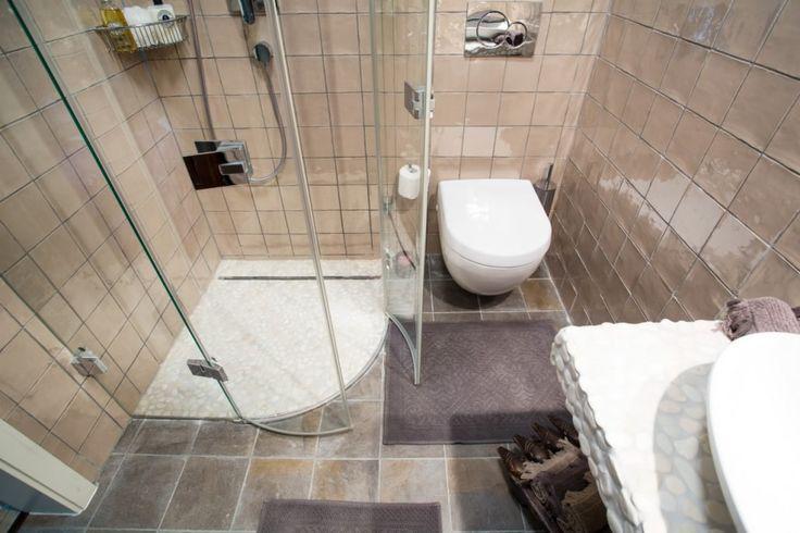 handmade glazed ceramic tiles and glass shower.