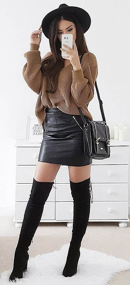 how to style a sweater : black hat + bag + leather skirt + over the knee boots