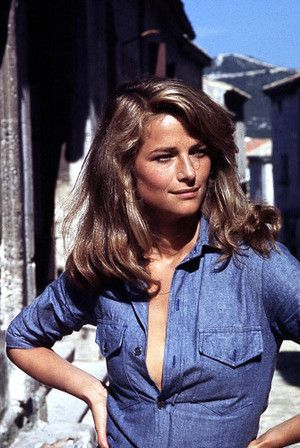 Charlotte Rampling, vintage style icon, wearing denim blouse.