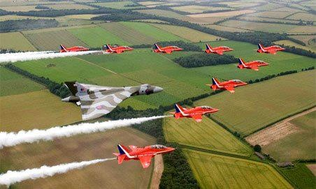 Vulcan bomber with ? Harriers // Er, no - it's the Royal Air Force Aerobatic Team or 'The Red Arrows' - and they are Hawks :)