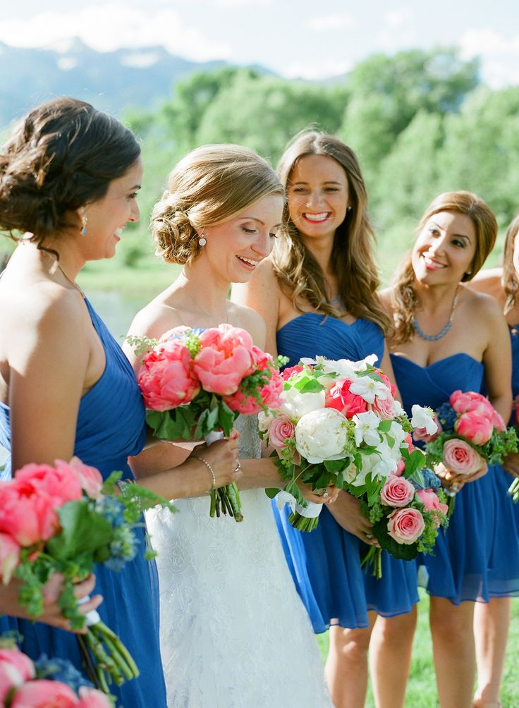 Pretty maids in blue. Photography: Carrie Patterson Photography - carriepattersonphotography.com, Bridesmaids' Dresses: J.Crew - jcrew.com  Read More: http://www.stylemepretty.com/2014/06/04/rustic-jackson-hole-wedding/